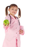 Girl, a doctor, the child, apple. Children dressed as doctors, nurses Stock Photo