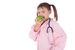 Girl, a doctor, the child, apple Royalty Free Stock Images