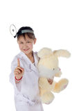 Girl, a doctor, the child, rabbit toy Stock Images