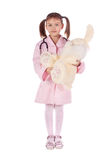 Girl, a doctor, the child, rabbit toy Royalty Free Stock Photo