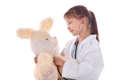 Girl, a doctor, the child, rabbit toy Royalty Free Stock Photography