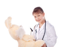Girl, a doctor, the child, rabbit toy Royalty Free Stock Images