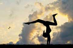 Girl does contortion at sunset Royalty Free Stock Photography