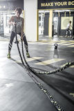 Girl does exercise with fitness rope in gym Royalty Free Stock Photo