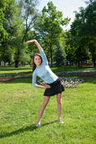 Girl does exercise leaning aside Royalty Free Stock Photo