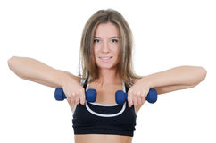 The girl does exercises with dumbbells Royalty Free Stock Photos