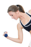 The girl does exercises with dumbbells Stock Image