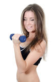 The girl does exercises with dumbbells Stock Photos
