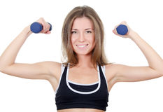 The girl does exercises with dumbbells isolated Royalty Free Stock Photography