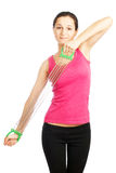 The girl does fitness exercises with expander. On a white background Stock Images