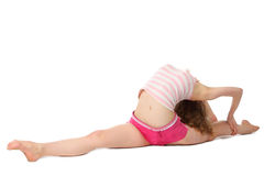 Girl does gymnastic exercise. Girl in sportswear does gymnastic exercise on floor, making splits Royalty Free Stock Image