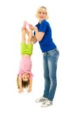 The girl does gymnastics with the child Stock Image