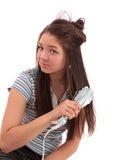 Girl does a hairdress, isolated. Stock Photo