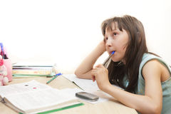 Girl does homework Stock Photos