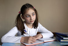 The girl does homework Royalty Free Stock Images