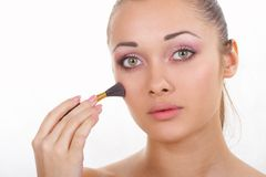 Girl does a make-up Royalty Free Stock Photography