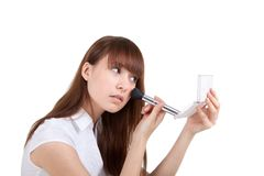 The girl does a make-up Stock Image