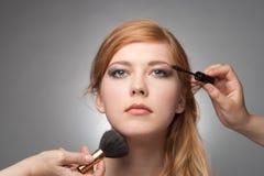 Girl does a make-up Stock Photos