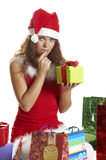 Girl does not know what to make with gifts Stock Images