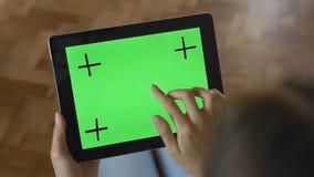 Girl Does Slide Gestures on Tablet stock video footage