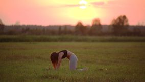 Girl does yoga stock video footage