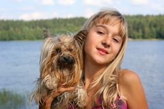 Girl and dog. Young girl holding a Yorkshire terrier dog Stock Photography