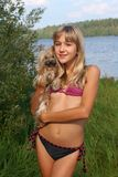 Girl and dog. Young girl holding a Yorkshire terrier dog Stock Images