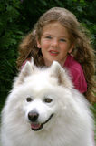 girl with dog. Young girl with dog in the park Royalty Free Stock Photo