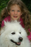 Girl with dog. Young girl with dog in the park Royalty Free Stock Image