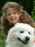 girl with dog. Young girl with dog in the park Stock Photos