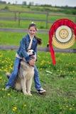 Girl with dog Stock Image