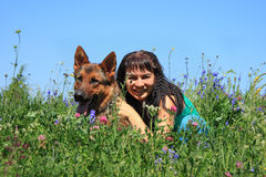 The girl with a dog. Sit in a grass Stock Image
