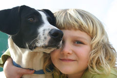 Girl with dog. A 6 year old girl is cuddling her dog. Closeup of their faces Stock Image
