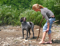 Girl and Dog 16. A young girl plays with dog at river. Summer, sunny day. Russian Far East, Primorye Stock Photo