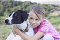 Girl with dog. Candid shot of a young girl holding a stray dog. Positive feeling Royalty Free Stock Photography