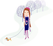 Girl with dog. Girl is walkin with dog in the winter park Stock Images