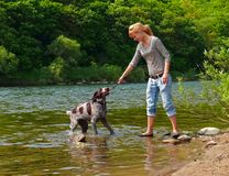 Girl and Dog 2. A young girl plays with dog at river. Summer, sunny day. Russian Far East, Primorye Stock Photography