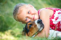 Girl with dog. Portrait of cute girl with dog on summer meadow Royalty Free Stock Images