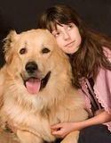The girl with the dog. The girl embraces a dog Royalty Free Stock Image