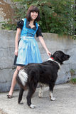 Girl and dog. A young woman in national costume fashion with her dog royalty free stock photography