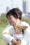 Girl and dog. Poodle dog kiss the shy little girl Royalty Free Stock Image