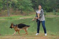 Girl and dog. Teenager girl and German Shepherd dog Royalty Free Stock Image