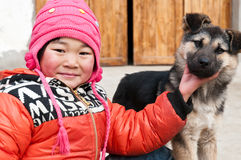 Girl and dog Stock Image
