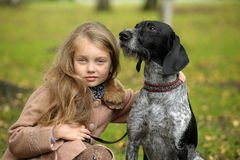 Girl with a dog. In the park Royalty Free Stock Photos