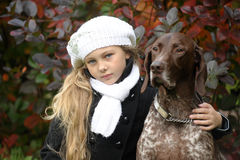 Girl with a dog Stock Image
