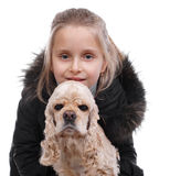 Girl and dog. Little girl in winter outwear with american spaniel on white background Royalty Free Stock Photos