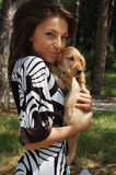 A girl and a dog Stock Images