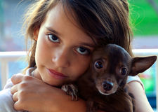 Girl and dog Stock Images