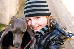 A girl with a dog. An eight years old girl holding a dog Stock Photography