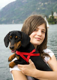 Girl with Dog. Girl with black dog near the algo Royalty Free Stock Photos